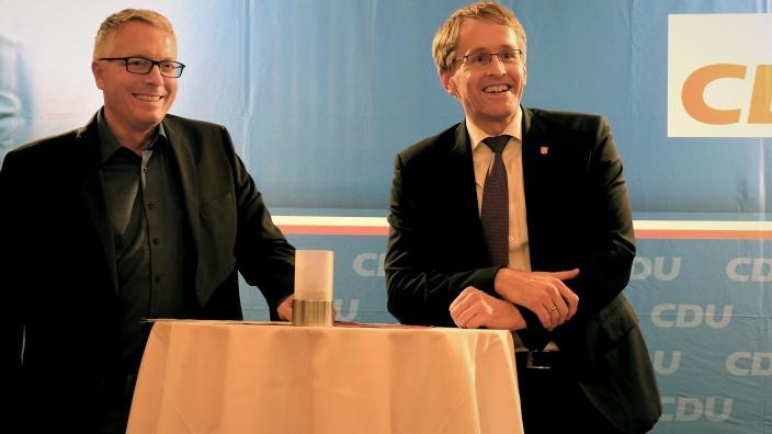 Arne Rüstemeier, Daniel Günther