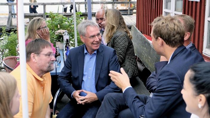 Mittendrin: Staatssekretär Torsten Geerdts, Minderheitenbeauftragter Johannes Callsen und Stadtrat Kleinschmidt